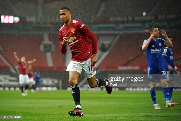 Mason Greenwood of Manchester United celebrates after scoring their side's first goal during the Premier League match between Manchester United and...