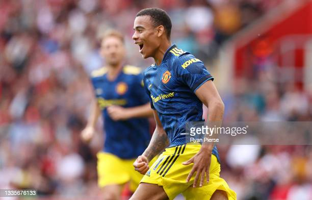 Mason Greenwood of Manchester United celebrates after scoring their side's first goal during the Premier League match between Southampton and...