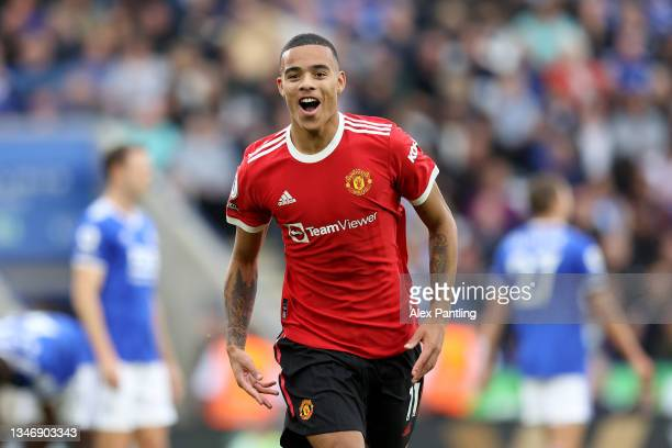 Mason Greenwood of Manchester United celebrates after scoring their side's first goal during the Premier League match between Leicester City and...