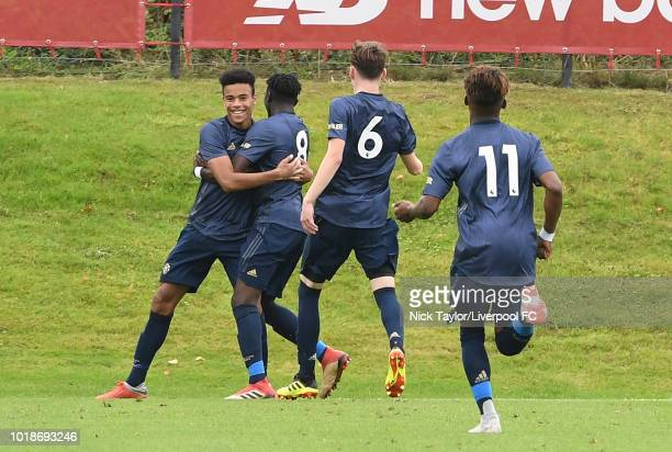 Mason Greenwood of Manchester United celebrates his goal with his team mates Allow Traore Jimmy Garner and Largie Ramazani during the Liverpool U18 v...