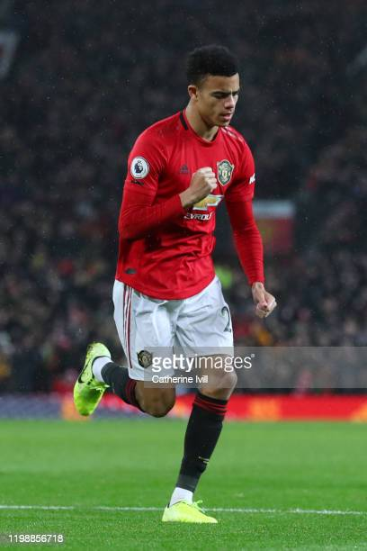 Mason Greenwood of Manchester United celebrates his team's fourth goal during the Premier League match between Manchester United and Norwich City at...