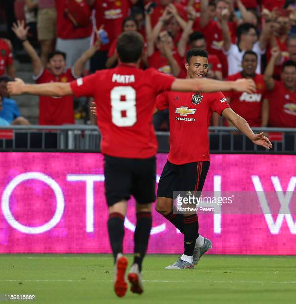 Mason Greenwood of Manchester United celebrates scoring a goal to make the score 1-0 with his team-mates during the 2019 International Champions Cup...
