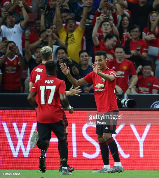 Mason Greenwood of Manchester United celebrates scoring a goal to make the score 1-0 during the 2019 International Champions Cup match between...
