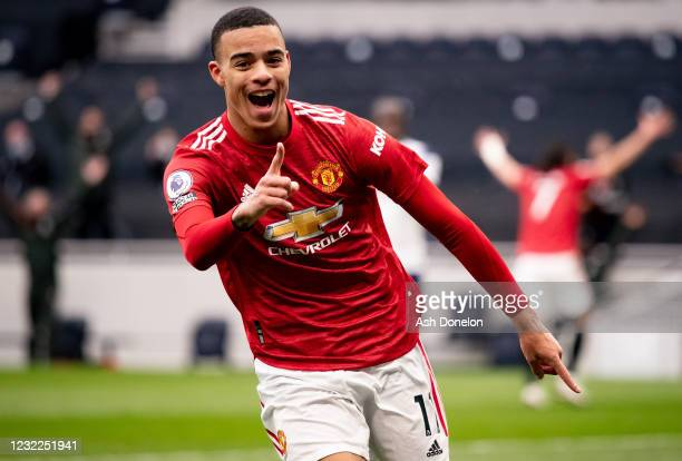 Mason Greenwood of Manchester United celebrates scoring a goal to make the score 1-3 during the Premier League match between Tottenham Hotspur and...