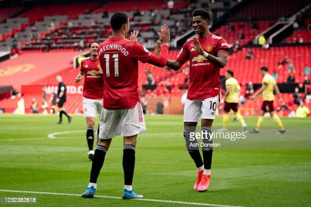 Mason Greenwood of Manchester United celebrates scoring a goal to make the score 1-0 with Marcus Rashford during the Premier League match between...