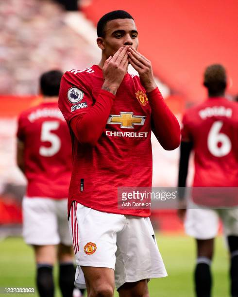 Mason Greenwood of Manchester United celebrates scoring a goal to make the score 2-1 during the Premier League match between Manchester United and...