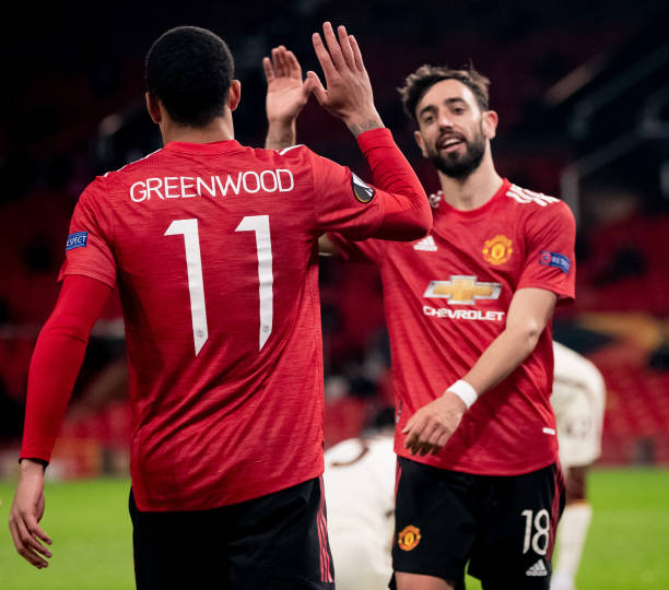Mason Greenwood of Manchester United celebrates scoring a goal to make the score 6-2 with Bruno Fernandes during the UEFA Europa League Semi-final...