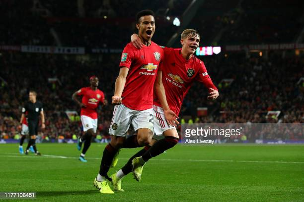 Mason Greenwood of Manchester United celebrates scoring his teams first goal of the game with team mate Brandon Williams during the Carabao Cup Third...