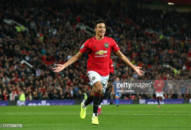 Mason Greenwood of Manchester United celebrates scoring his teams first goal of the game during the Carabao Cup Third Round match between Manchester...