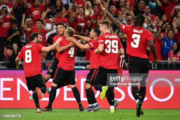 Mason Greenwood of Manchester United celebrates scoring the opening goal with his team mates during the 2019 International Champions Cup match...