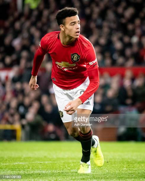 Mason Greenwood of Manchester United celebrates scoring their first goal during the Premier League match between Manchester United and Everton FC at...