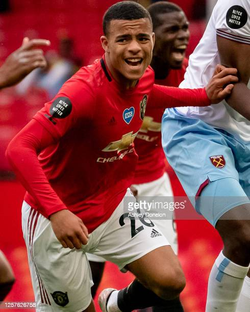 Mason Greenwood of Manchester United celebrates scoring their first goal during the Premier League match between Manchester United and West Ham...