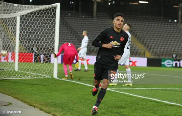 Mason Greenwood of Manchester United celebrates scoring their fourth goal goal during the UEFA Europa League round of 16 first leg match between LASK...