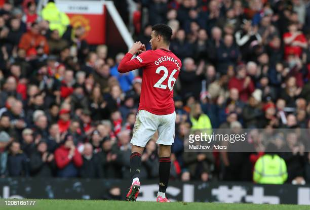 Mason Greenwood of Manchester United celebrates scoring their third goal during the Premier League match between Manchester United and Watford FC at...