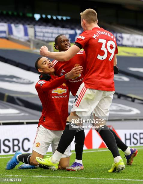 Mason Greenwood of Manchester United celebrates with Aaron Wan-Bissaka and Scott McTominay after scoring their side's third goal during the Premier...