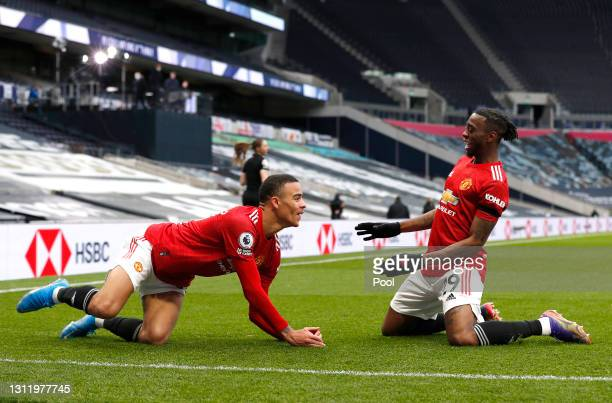 Mason Greenwood of Manchester United celebrates with Aaron Wan-Bissaka after scoring their side's third goal during the Premier League match between...