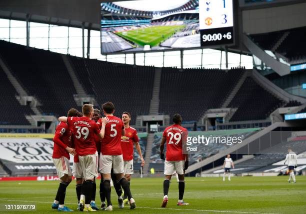 Mason Greenwood of Manchester United celebrates with Scott McTominay and Harry Maguire after scoring their side's third goal during the Premier...