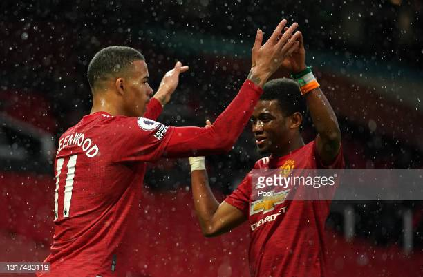 Mason Greenwood of Manchester United celebrates with team mate Amad Diallo after scoring their side's first goal during the Premier League match...