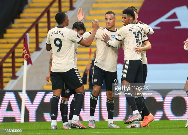 Mason Greenwood of Manchester United celebrates with team mates after scoring their second goal during the Premier League match between Aston Villa...