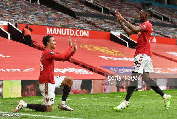 Mason Greenwood of Manchester United celebrates with teammate Aaron Wan-Bissaka after scoring his team's fourth goal during the Premier League match...