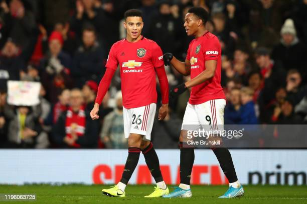 Mason Greenwood of Manchester United celebrates with teammate Anthony Martial after scoring his team's second goal during the Premier League match...