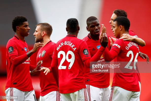 Mason Greenwood of Manchester United celebrates with teammates after scoring his team's first goal during the Premier League match between Manchester...