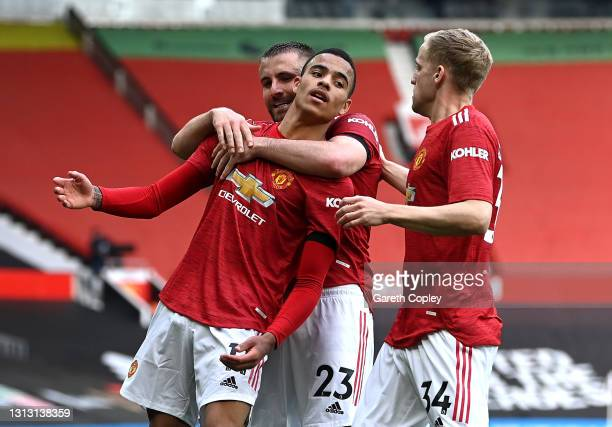 Mason Greenwood of Manchester United celebrates with teammates Luke Shaw and Donny van de Beek after scoring his team's second goal during the...