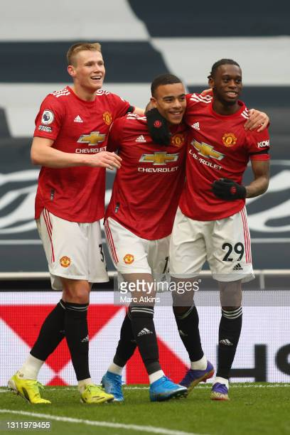 Mason Greenwood of Manchester United celebrates with teammates Scott McTominay and Aaron Wan-Bissaka after scoring his team's third goal during the...
