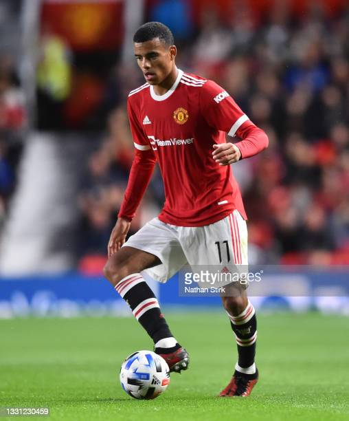 Mason Greenwood of Manchester United controls the ball during the pre-season friendly match between Manchester United and Brentford at Old Trafford...