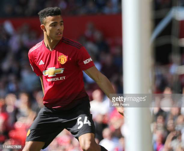 Mason Greenwood of Manchester United in action during the Premier League match between Manchester United and Cardiff City at Old Trafford on May 12...