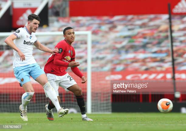 Mason Greenwood of Manchester United in action with Declan Rice of West Ham United during the Premier League match between Manchester United and West...