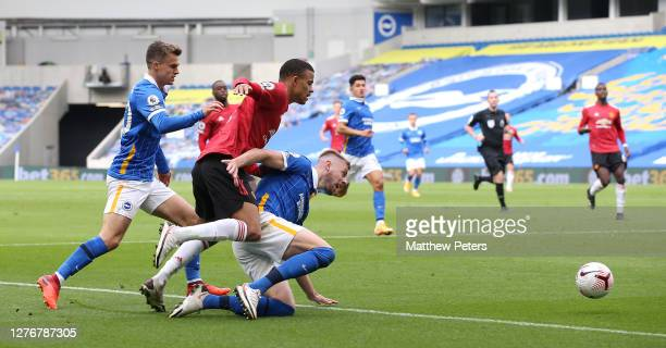 Mason Greenwood of Manchester United in action with Solomon March of Brighton and Hove Albion during the Premier League match between Brighton Hove...
