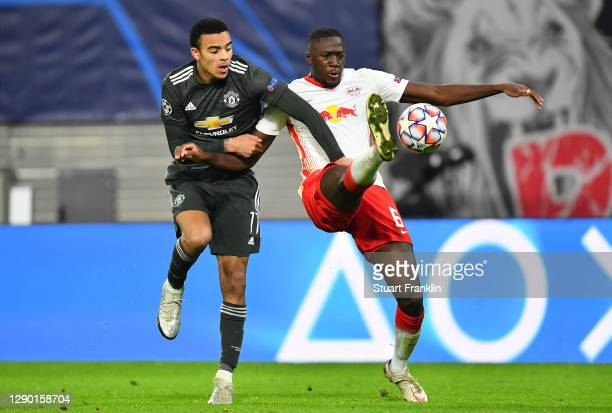 Mason Greenwood of Manchester United is fouled by Ibrahima Konate of RB Leipzig leading to a penalty for Manchester United during the UEFA Champions...