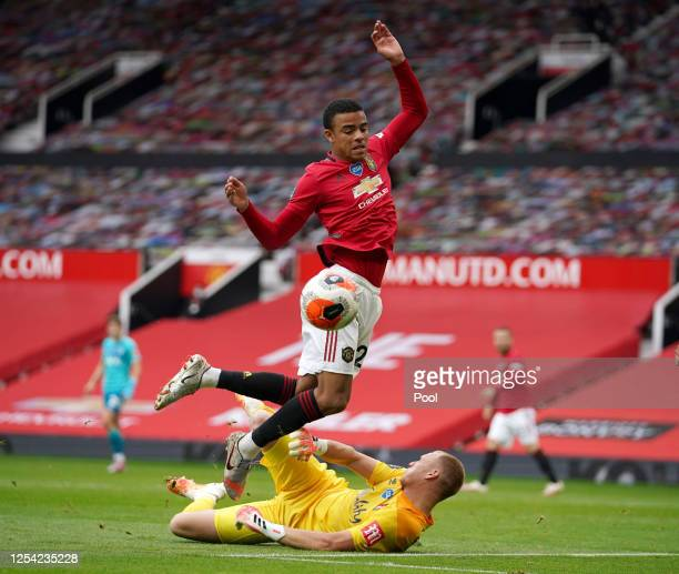 Mason Greenwood of Manchester United jumps over Aaron Ramsdale of AFC Bournemouth during the Premier League match between Manchester United and AFC...