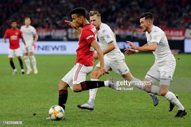 Mason Greenwood of Manchester United passes the ball during a preseason friendly match between Manchester United and Leeds United at Optus Stadium on...