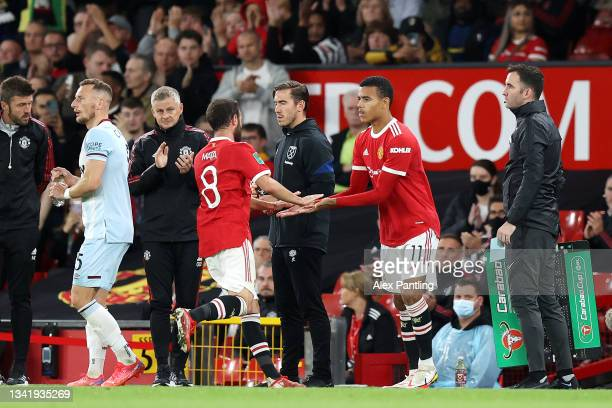 Mason Greenwood of Manchester United replaces teammate Juan Mata during the Carabao Cup Third Round match between Manchester United and West Ham...