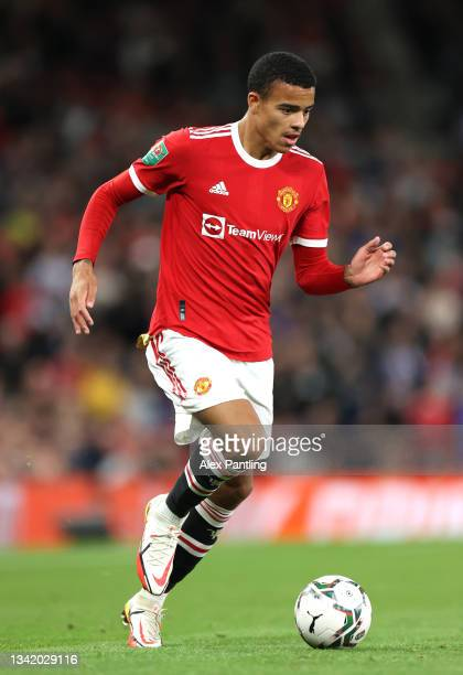 Mason Greenwood of Manchester United runs with the ball during the Carabao Cup Third Round match between Manchester United and West Ham United at Old...