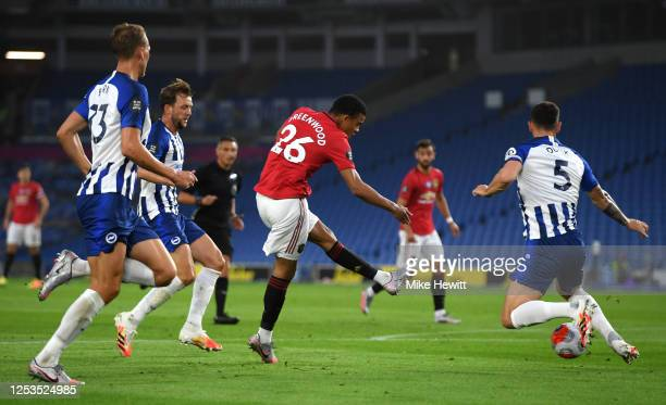 Mason Greenwood of Manchester United scores his sides first goal during the Premier League match between Brighton & Hove Albion and Manchester United...