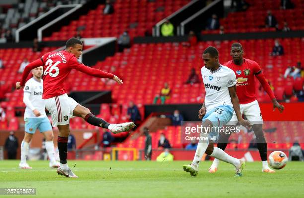 Mason Greenwood of Manchester United scores his team's first goal during the Premier League match between Manchester United and West Ham United at...