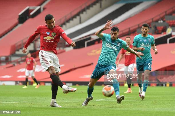Mason Greenwood of Manchester United scores his team's fourth goal as he is challenged by Diego Rico of AFC Bournemouth during the Premier League...