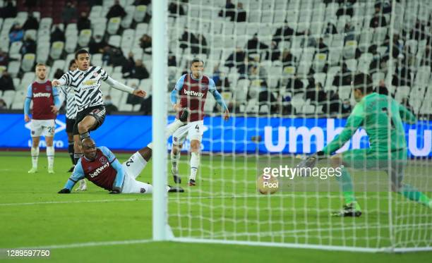 Mason Greenwood of Manchester United scores his team's second goal past Lukasz Fabianski of West Ham United during the Premier League match between...