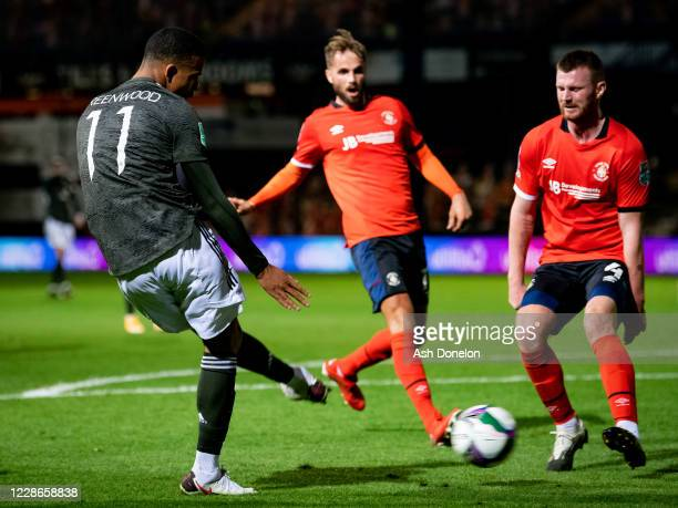 Mason Greenwood of Manchester United scores his teams third goal during the Carabao Cup Third Round match between Luton Town and Manchester United at...