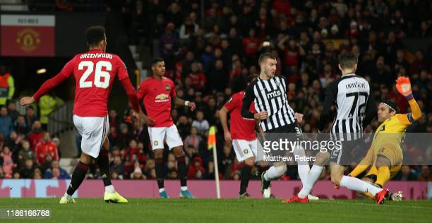 Mason Greenwood of Manchester United scores their first goal during the UEFA Europa League group L match between Manchester United and Partizan at...