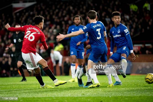 Mason Greenwood of Manchester United scores their first goal during the Premier League match between Manchester United and Everton FC at Old Trafford...
