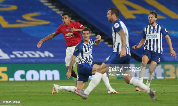 Mason Greenwood of Manchester United scores their first goal during the Premier League match between Brighton & Hove Albion and Manchester United at...