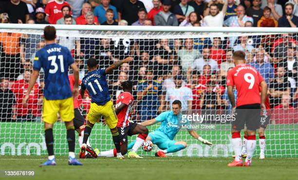 Mason Greenwood of Manchester United scores their side's first goal past Alex McCarthy of Southampton during the Premier League match between...