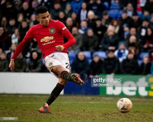 Mason Greenwood of Manchester United scores their sixth goal during the FA Cup Fourth Round match between Tranmere Rovers and Manchester United at...