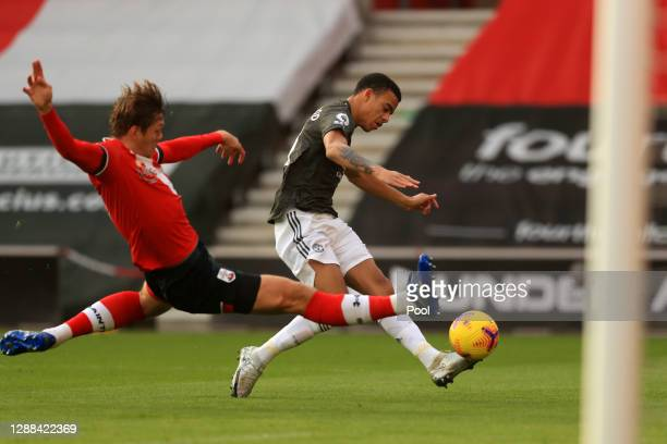 Mason Greenwood of Manchester United shoots and misses whilst under pressure from Jannick Vestergaard of Southampton during the Premier League match...