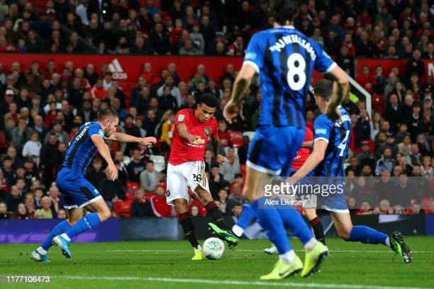Mason Greenwood of Manchester United shoots and scores his teams first goal during the Carabao Cup Third Round match between Manchester United and...