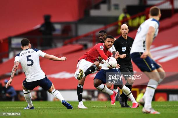 Mason Greenwood of Manchester United shoots past PierreEmile Hoejbjerg of Tottenham Hotspur during the Premier League match between Manchester United...